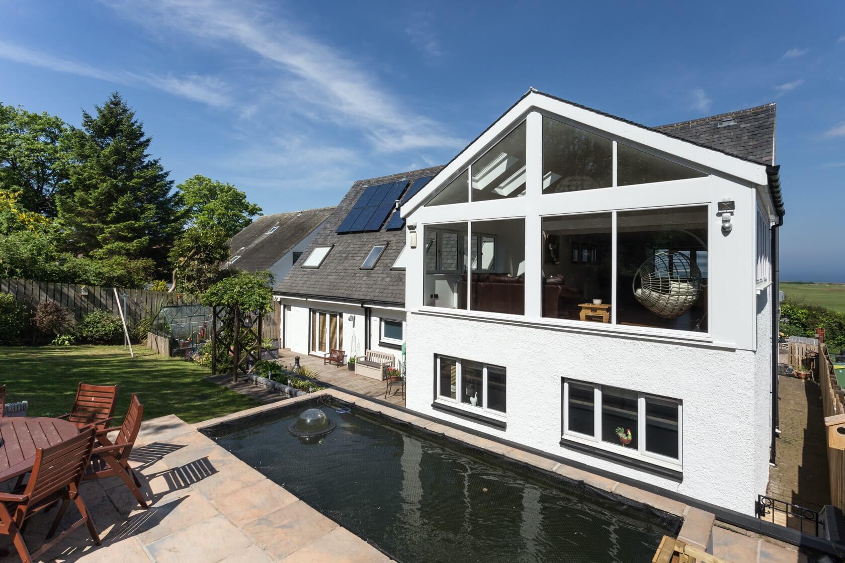 Sunroom extension on flat roof at Back Road Dunbar 3