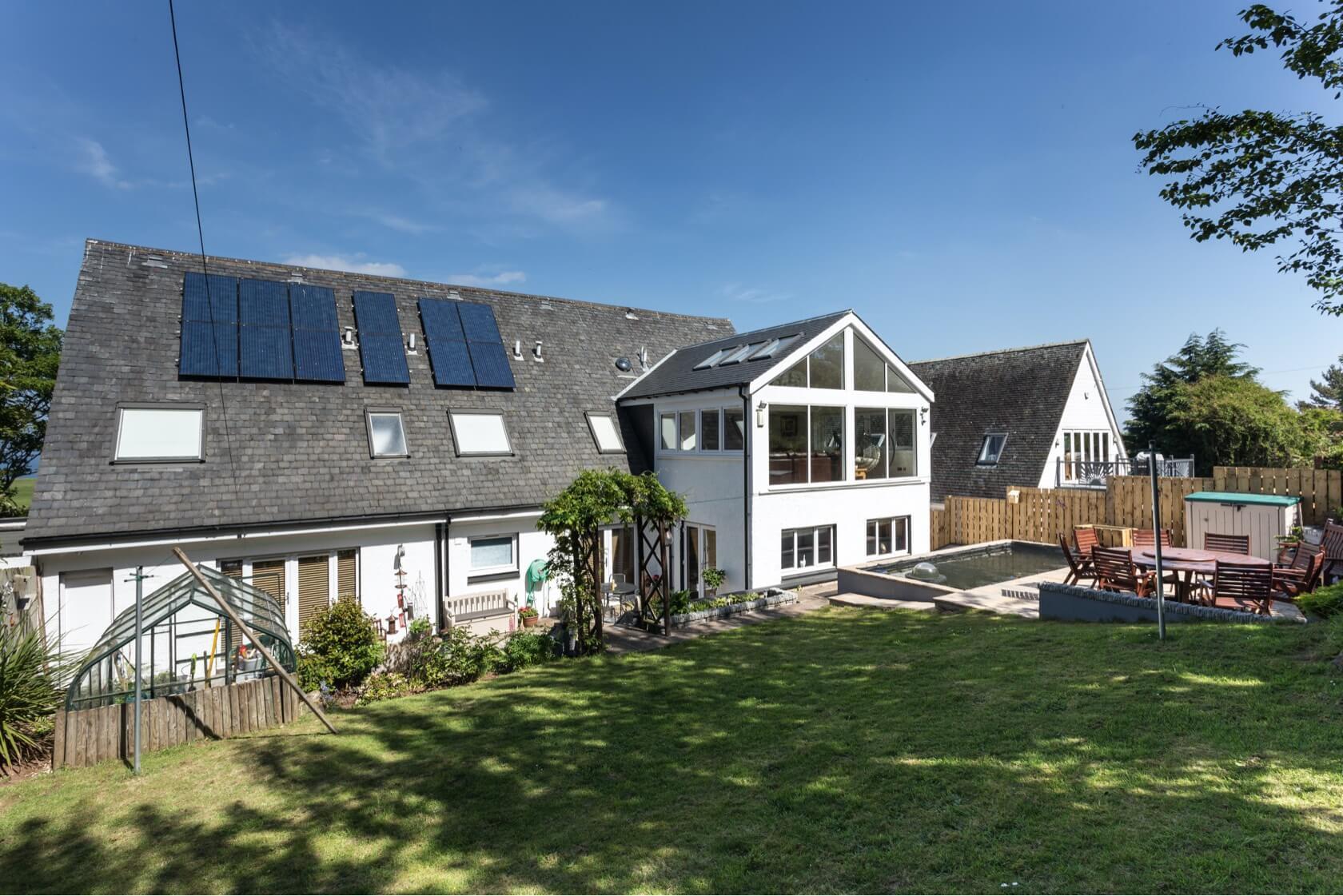 Sunroom extension on flat roof at Back Road Dunbar 4